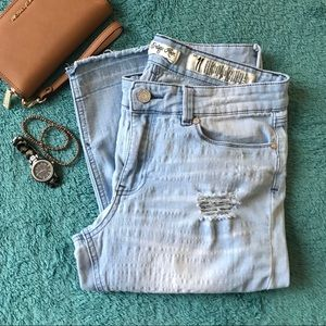 Highly distressed denim crops jeans